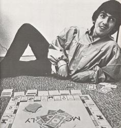George playing Monopoly.