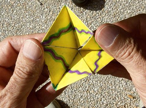 Flexing a hexaflexagon, step 5.